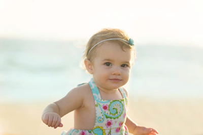 Photo: A happy baby on the beach