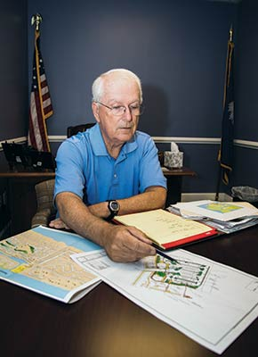 Mayor Dick Cronin looks over IOP Marina plans