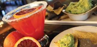 a margarita with chips and guacamole at SOL Southwest Kitchen & Tequila Bar